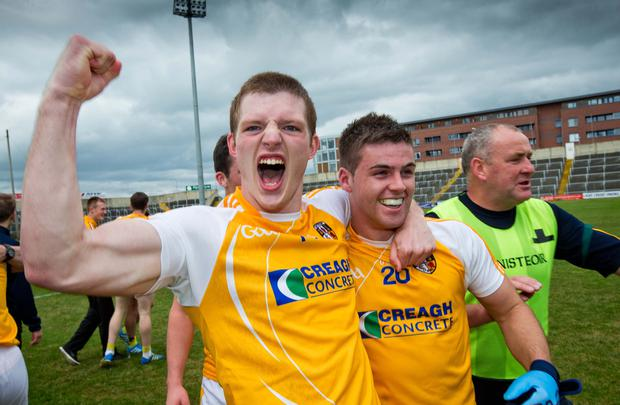 Comeback kings: Owen Gallagher and Patrick McBride celebrate Antrim's All-Ireland qualifier win over Laois in Portlaois after the Saffrons had found themselves eight points behind