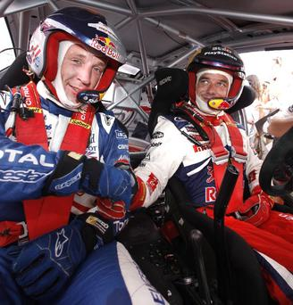 Backing: Kris Meeke (left) has been given a vote of confidence by nine-time World king Sebastien Loeb (right) to lead Citroen