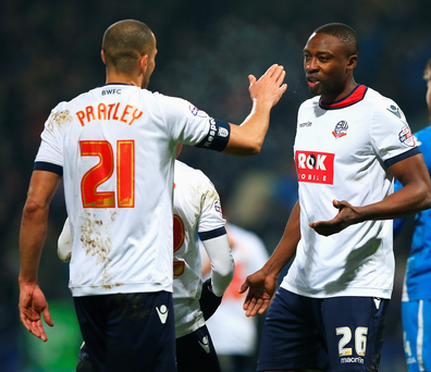 Relief: Bolton's Darren Pratley (left) celebrates with Shola Ameobi after scoring his team's third goal at Macron Stadium