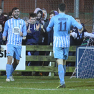 Net gains: Johnny McMurray celebrates his strike for Town