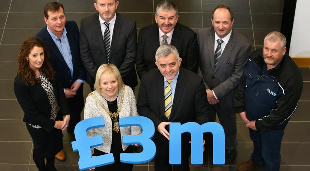 Pictured, (front) Michelle Knight-McQuillan, Mayor and Enterprise Trade & Investment Minister, Jonathan Bell. (Back row left to right) Karen Fryer, Seating Matters, Michael Devine, Annies Traditional Food Ltd, Stephen OÕHara, RCDS, Philip Smyth, P&L Electricals Ltd, Hugh OÕBoyle, Carnroe Supplies Ltd and Alan Barr, Limavady Roller Doors Ltd. Photo by William Cherry/PressEye
