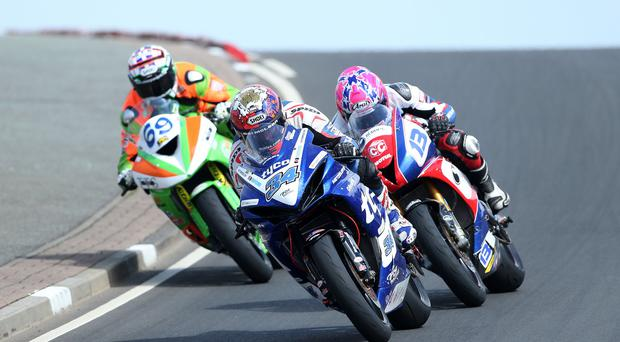 Close call: Glenn Irwin (Gearlink Kawasaki), Alastair Seeley (Tyco Suzuki) and Lee Johnston (East Coast Construction Triumph) battle during the Bet McClean Sportsport Race