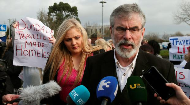 Sinn Fein leader Gerry Adams addresses Travellers attending a protest at a Louth County Council offices after residents were evicted from a fire-risk halting site in Dundalk.