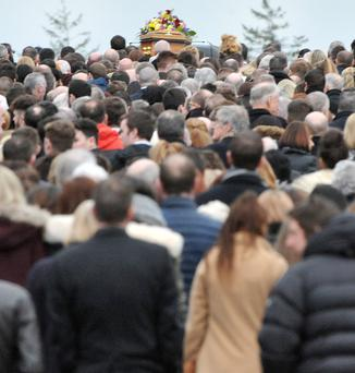 Mourners follow the coffin of Ellen Finnegan who died after a blaze broke out in her father's flat