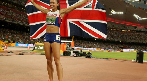 Flag day: Jessica Ennis-Hill celebrates after winning the Heptathlon gold at the World Athletics Championships in Beijing