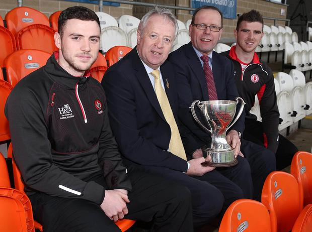 D Day for Daniel: Daniel McKinless (Derry), Martin McAviney (Ulster GAA President), Bernard Rooney (Bank of Ireland UK) and Conor McAliskey (Tyrone) at a press conference ahead of tonight's Bank of Ireland Dr McKenna Cup Final at Armagh Athletics Ground