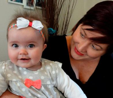 Seven-month-old Ruby Davies with her mother Tara, from Treboeth in Wales, after Ruby spent three months in plaster from her chest to her knees when it was discovered she was born with a condition known as hip dysplasia which if left uncorrected can lead to problems later in life.