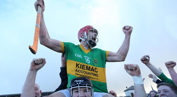 Creggan's Conor McCann is lifted on the shoulders of Kevin Rice as they celebrate their win over Ballysaggart