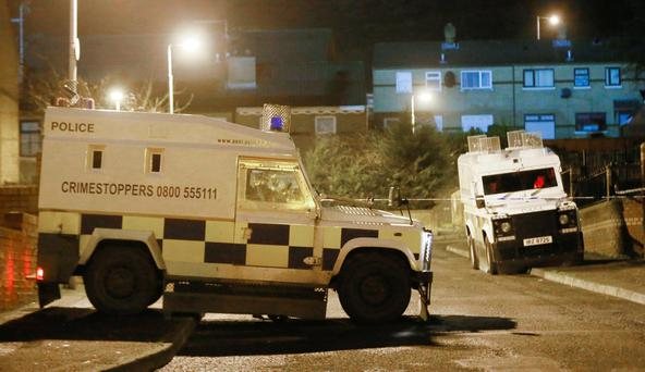 Police officers at the scene of a shooting incident in the Ardmonagh Parade area of west Belfast (photo Kevin Scott/Press Eye)