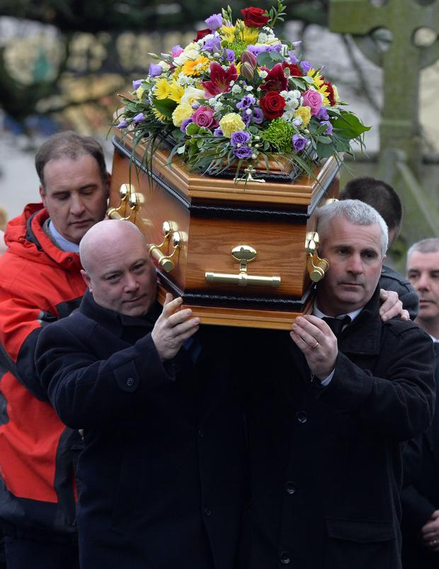 Mourners carry the coffin at the funeral of Ellen Finnegan