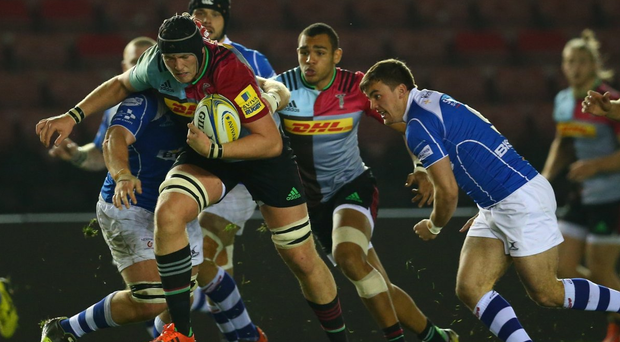 Running man: Kieran Treadwell, on the charge for Harlequins, will join Ulster in the summer