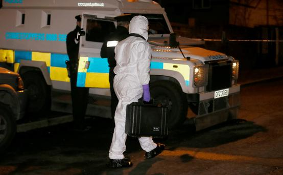 Forensics examine the scene in west Belfast where a teenager was shot (photo Kevin Scott/Press Eye)