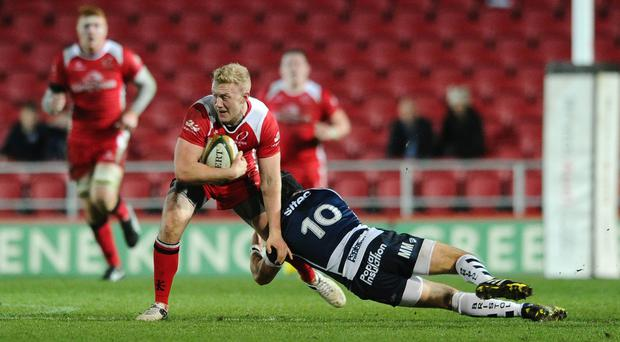 Ulster Outside Centre Stuart Olding (captain) is tackled by Bristol Rugby Fly-Half Matthew Morgan