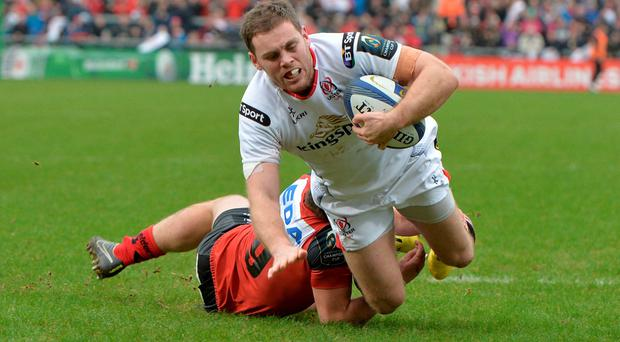 Darren Cave of Ulster scores a try during the European Champions Cup Pool 1 Round 6 game between Ulster and Oyonnax at Kingspan Stadium on January 23, 2016 in Belfast, Northern Ireland. (Photo by Charles McQuillan/Getty Images)