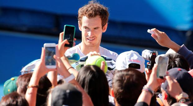 Snapchat: Andy Murray poses for fans after a practice session in Melbourne yesterday... but will he be in the Final picture on Sunday, even if he keeps winning?