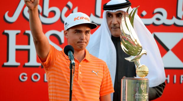 Thumb player: Ricky Fowler hails his victory in the Abu Dhabi Championship and, inset, Rory McIlroy finished joint third
