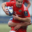On the run: Conor Murray launches Munster attack