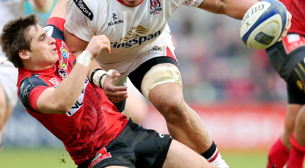 Within reach: Ulster's Nick Williams is tackled by Julien Blanc of Oyonnax