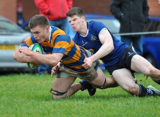 Damage done: Bangor's Matthew Agnew scores a try