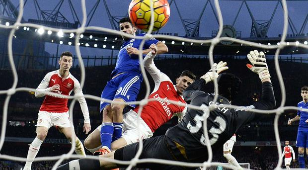 Got the blues: Chelsea's Diego Costa scores the winner against Arsenal