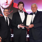 On the up: Iain Henderson is presented with his trophy from all time rugby great Willie John McBride and Director of Rugby at Ulster, Les Kiss