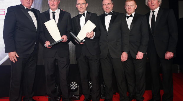Green and white heroes: Gerry Armstrong, Michael O'Neill, Martin O'Neill, Neil Lennon and Pat Jennings with their awards alongside Chris Nelmes, Centre Manager of category sponsor The OUTLET Banbridge
