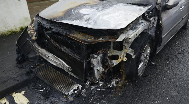The car after it was set alight in the Ebor Street area of Belfast on Tuesday Morning, The Fire service attended the scene. Pic Colm Lenaghan/Pacemaker