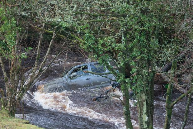 A pick up lies on it's side in a river at Crebarkey Road outside Dungiven. Picture Martin McKeown. Inprespics.com. 26.01.16