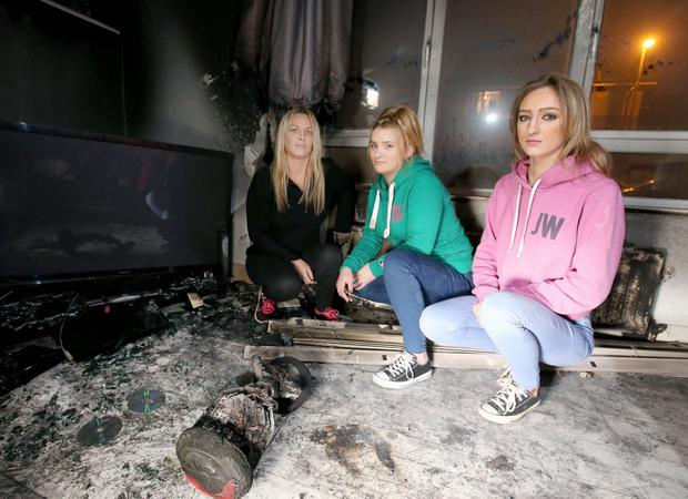 Sharon Massey and her children pictured at home, on Ardgowan Street in east Belfast after a hoverboard she bought her daughter for Christmas apparently caught fire while charging. Picture credit © Matt Mackey - Presseye.com