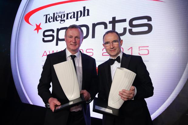 Prize guys: Michael and Martin O'Neill with their respective Belfast Telegraph Manager of the Year and Hall of Fame awards