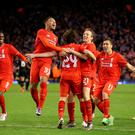 """Liverpool's Joe Allen (centre) is mobbed by team-mates after scoring the winning goal in the penalty shootout, during the Capital One Cup, semi final, second leg at Anfield, Liverpool. PRESS ASSOCIATION Photo. Picture date: Tuesday January 26, 2016. See PA story SOCCER Liverpool. Photo credit should read: Martin Rickett/PA Wire. RESTRICTIONS: EDITORIAL USE ONLY No use with unauthorised audio, video, data, fixture lists, club/league logos or """"live"""" services. Online in-match use limited to 75 images, no video emulation. No use in betting, games or single club/league/player publications."""
