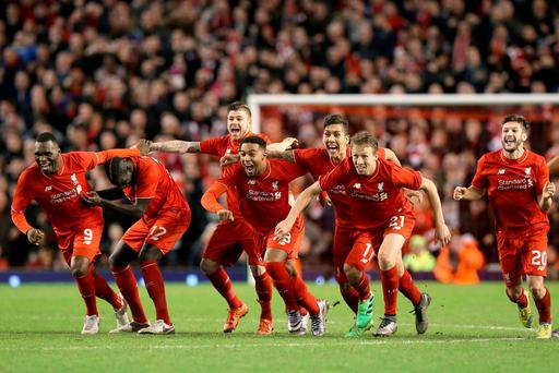 Liverpool players celebrate winning the penalty shootout, during the Capital One Cup, semi final, second leg at Anfield, Liverpool. PA