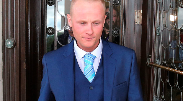 A warrant has been issued for the arrest of a Belfast man who was convicted in his absence of threatening to shoot loyalist Jamie Bryson