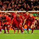 Wembley here we come: Liverpool players celebrate winning their Capital One Cup semi-final against Stoke 6-5 on penalties — Joe Allen scoring the crucial spot-kick