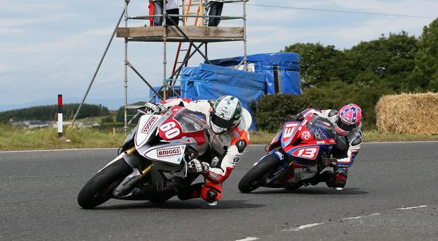 Grand day out: Peter Hickman leads Lee Johnston during an epic Superstock race at the Ulster Grand Prix but there are plenty of other contenders for the Race of the Year award