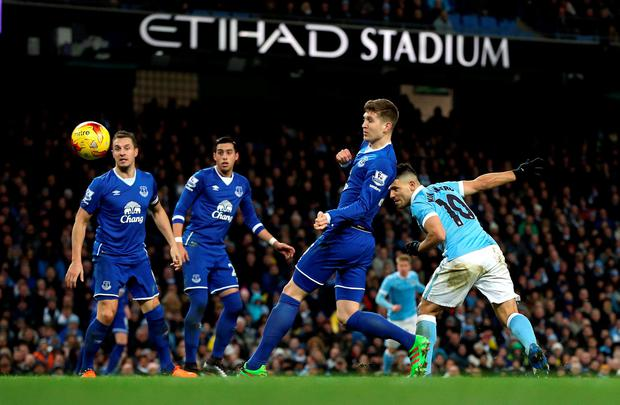 Manchester City's Sergio Aguero scores his side's third goal of the game during the Capital One Cup, semi final, second leg at the Etihad Stadium, Manchester. PA