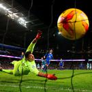 Goalkeeper Joel Robles of Everton dives in vain as Sergio Aguero (C) of Manchester City scores the winning goal to take his team to the final during the Capital One Cup Semi Final, second leg match between Manchester City and Everton at the Etihad Stadium on January 27, 2016 in Manchester, England. (Photo by Alex Livesey/Getty Images)