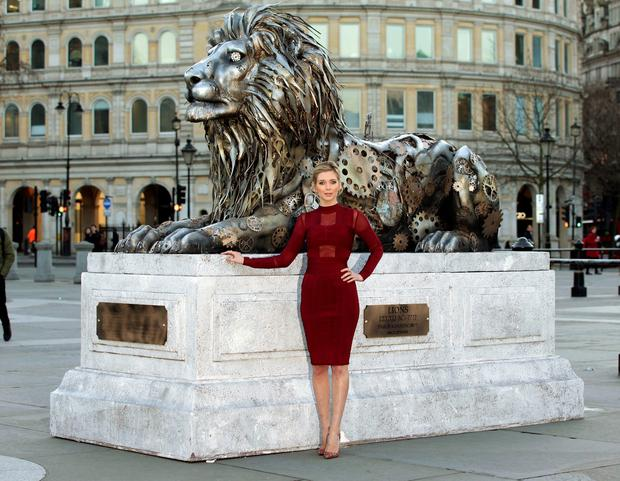 Rachel Riley at the unveiling of a fifth lion statue - sculpted from clock parts as a warning of possible extinction of the species within our lifetime - in Trafalgar Square, London. PA