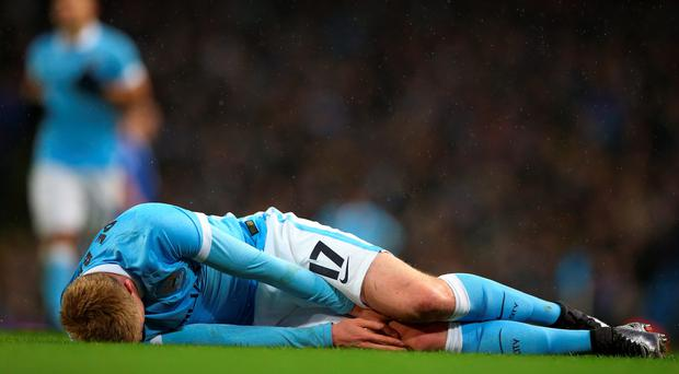 Sorry sight: Manchester City's Kevin De Bruyne lies injured at the Etihad during Capital One Cup semi-final against Everton