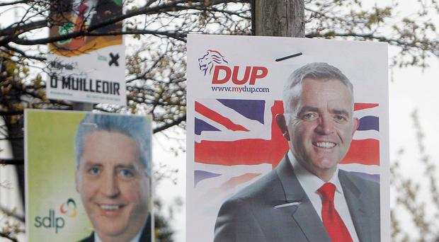 Posters of politicians festoon lamp posts in Belfast