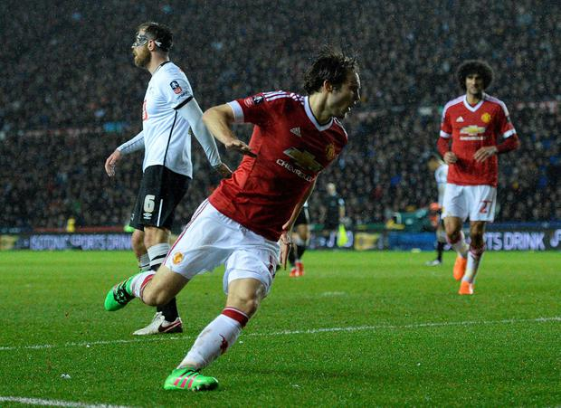 Manchester United's Dutch midfielder Daley Blind (C) celebrates scoring his team's second goalduring the FA cup fourth round football match between Derby County and Manchester United at Pride Park stadium in Derby on January 29, 2016.