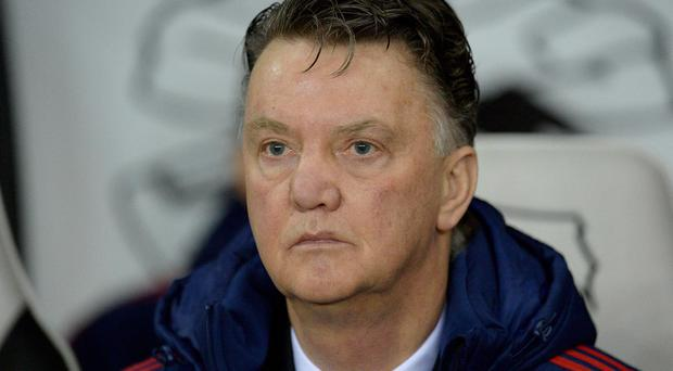 Manchester United manager Louis van Gaal watches his side against Derby in the FA Cup last night