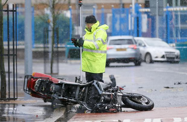 The early morning motorbike crash on the Falls Road (Photo by Kevin Scott / Presseye)
