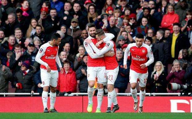 Arsenal's Calum Chambers (second right) celebrates scoring his side's first goal of the game with teammates during the Emirates FA Cup, fourth round match at the Emirates Stadium, London. Pic John Walton/PA Wire