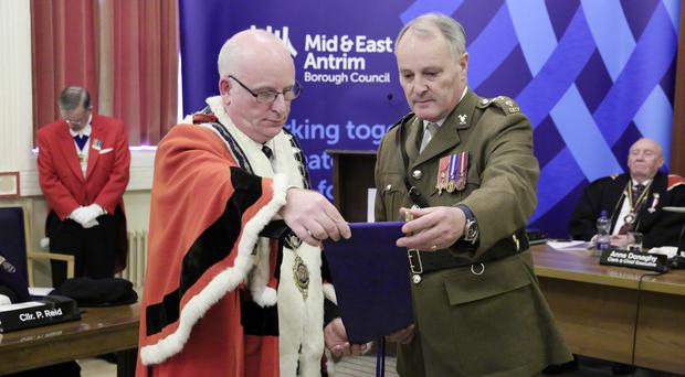 Press Eye - Belfast - Saturday 30th January 2015 - Mid and East Antrim Borough Council has conferred its first ever Freedom of the Borough on B (North Irish Horse) Squadron of The Scottish and North Irish Yeomanry. Regimental Honorary Colonel, Dr Melfort Campbell is pictured at Carrickfergus Town Hall with the Freedom Scroll along with the Mayor, Councillor Billy Ashe in the Jubilee Hall, Carrickfergus. Picture by Kelvin Boyes / Press Eye.