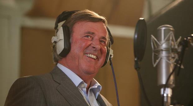 Sir Terry Wogan as he announced he was stepping down from his BBC Radio 2 breakfast show, he told listeners of the long-running and much-loved Wake Up to Wogan' that he would be stepping down at the end of the year to be replaced by Chris Evans.
