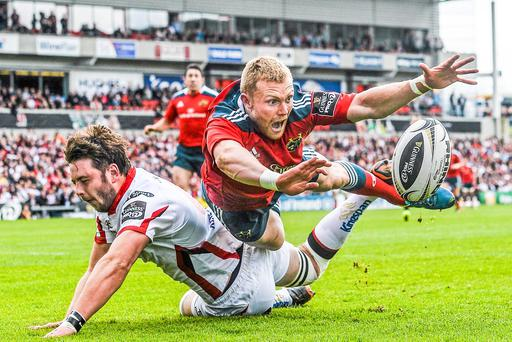 """""""It's mine"""" Keith Earls, Munster, dives for the try line despite the efforts of Iain Henderson, Ulster by Ramsey Cardy, this image was placed first in the PPAI awards Sports Action category"""