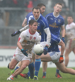 On the ball: Tyrone's Mark Bradley takes control against Cavan at Healy Park