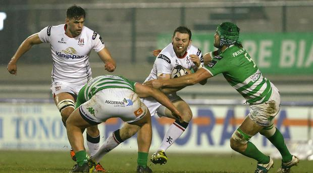 Moving forward: Darren Cave is tackled by Tom Palmer