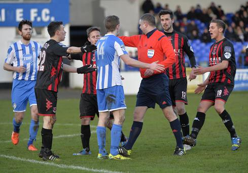 Point of controversy: referee Raymond Crangle awards Crusaders a penalty but the tackle took place outside the area